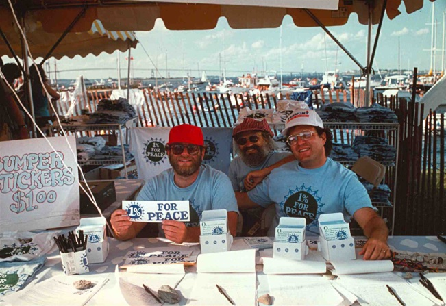 1% For Peace was the coming-out party for the social mission of  Ben  & Jerry's. This shows (ll-r) Ben, Jeff, and Jerry working  a table at the Newport Folk Festival in the early 1990s.